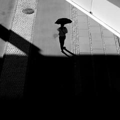 Out of the Shade (Jan Jespersen) Tags: denmark københavn platea plateastreetphotocollective tivolihotel bw blackandwhite city citylife copenhagen monochrome street streetphoto streetphotography urban urbanlife urbanscene urbanscenes
