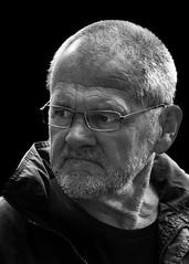 Portrait (D80_539312) (Itzick) Tags: denmark copenhagen candid bw blackbackground bwportrait glasess man face facialexpression beard portrait streetphotography d800 itzick