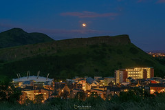 Lunar eclipse over Edinburgh (MilesGrayPhotography (AnimalsBeforeHumans)) Tags: sonyfe24105mmf4goss fe24105mmf4goss sonya7rii a7rii sonyilce7rm2 ilce7rm2 arthursseat caltonhill britain city eclipse lunareclipse edinburgh glow historic iconic landscapephotography scottishlandscapephotography landscape nightscape outdoors photography moon sky salisburycrags crags scottish scotland sony summer town uk unitedkingdom glens