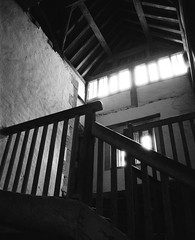 Bakehouse, Lacock Abbey (a.pierre4840) Tags: olympus om2n zuiko 24mm f28 35mmfilm ilford ilfordfp4 fp4 bw blackandwhite noiretblanc stairs staircase wood ambientlight angle perspective lines architecture