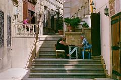 Baku Old City Backgammon (Packing-Light) Tags: 35mm azerbaijan baku caucasus eurasia nikonf6 analog emulsion film fujicolor fuji superia400 city street