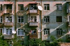 Baku Apartment Vignette (Packing-Light) Tags: 35mm azerbaijan baku caucasus eurasia nikonf6 analog emulsion film fujicolor fuji superia400 city street