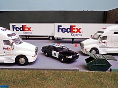 Oakland PD at the FedEx Hub (Phil's 1stPix) Tags: greenlight42870d 164scalefordcvpioaklandpolice oaklandcaliforniapolice 2008fordcrownvictoriapoliceinterceptor oaklandpd oaklandpolicedepartment cityofoaklandcaliforniausa greenlighthotpursuitseries30 policeresponse diecast diorama 1stpix diecastdiorama 164scalediecast phils1stpix 1stpixphoto firstpix 1stpixdiecastdioramas 164scalediorama 1stpixdioramas 164greenlightcollectibles greenlightdiecast cop policediecast policemodel policecar 1stpixdiecast 1stpixdiorama 2008fordcvpi policepatrol patrolfunctions oaklandpoliceofficer oaklandpdcvpi oaklandpolicepatrol fedexdepot fedexdistributioncenter goldenwheelfedextruck goldenwheeldiecast fedexdiecasttruck 187dumpster dumpsterdiorama fedexhubdiorama
