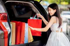 Asian girl shopping with mid year sales (I love landscape) Tags: car bags woman keep female happy shopping fashion joy bag customer consumer shopper business holiday smile man looking park leisure expression freedom successful asian asia thai lady vehicle commercial economy laughing relaxed coat carry visit traveling sympathetic motorists beautiful people adult girl lifestyle promotion department store parking relax back door