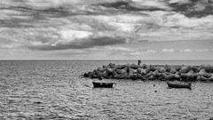 Funchal classic seaview. (Wbaskerville) Tags: classic sea boat clouds sky pier visitmadeira madeira funchal bnwphotography blackandwhite blackandwhitephotography stonewall fishingboats classicpictures leica leicam leicam240 leicamonochrome 35mm sumilux35mm