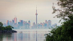 Steamy Summer (Brady Baker) Tags: toronto canada ontario city skyline water lake humber bay park west view calm reflection tree nature outdoor sunset dusk cityscape urban greenspace colorful cntower building architecture modern summer mist steam heat fog