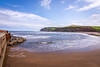 SJ1_9248 - Skinningrove (SWJuk) Tags: swjuk uk unitedkingdom gb britain england yorkshire northyorkshire clevelandway skinningrove coast coastal seaside beach sand pier headland sea ocean waves northsea bluesky clouds light sunlight 2019 jul2019 summer holidays nikon d7200 nikond7200 tokina1116 wideangle rawnef lightroomclassiccc seascape landscape