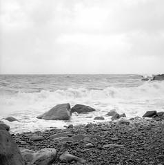 Hankering (ronet) Tags: hasselblad500cm beach blackandwhite devon diydeveloped exmoor film heddonsmouth ilford ilforddelta100 mediumformat nationaltrust pebbles rocks sea waves