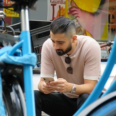 Framed (gerben more) Tags: bike bicycle beard youngman handsomeman cellphone amsterdam