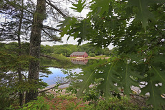 Blue Hill boat house (GLC 392) Tags: blue hill bay falls boat house cove water pond lake frame tree trees reflection clouds coudy tourist touristy local postcard post card me maine