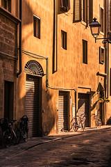 Respite (Prestidigitizer) Tags: buildings italy florence firenze pentaxk3 sigma18250mm streets morninglight golden bike bicycle