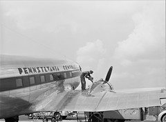 Pre-fight: Oil for the engine of an airliner preparatory to takeoff. Municipal airport, Washington, D.C. July 1941. (polkbritton) Tags: jackdelano 1940s washingtondchistory fsaowi airplanes travel libraryofcongresscollections streamlinemoderne