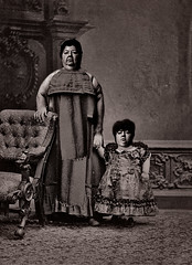MOTHER AND CHILD REUNION: In the landmark case of Anous versus Ludmilla, artificial intelligence was used to positively and indisputably match this mother and daughter, rendering DNA testing in maternity lawsuits superfluous. Finally, a use for AI that ma (Fotofricassee) Tags: mother child face apple tree genes victorian