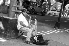 """The musician, playing """"Besame mucho"""" a very famous spanish song. (Capitancapitan) Tags: songwriter song musician play music neury luciano urim y tumim el mundo gira pentax k500 k50 camera iphone instagram facebook youtube walk people nyc new york manhattan bronx street photography besame mucho"""