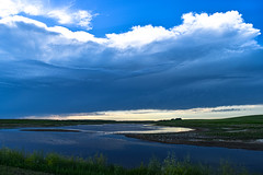As the Supercell forms (darletts56) Tags: sky blue white cloud clouds water supercell form forming forms dug out dugout man made field fields prairie storm dusk sunset grass green reflection saskatchewan canada movement wind winds bird birds swim swimming grey country