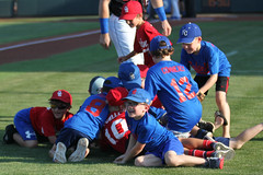 Dogpile! (Minda Haas Kuhlmann) Tags: sports baseball milb minorleaguebaseball pacificcoastleague omahastormchasers nebraska omaha sarpycounty outdoors fans onfieldpromotions
