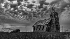 Last Day in Dooley (Flint Roads) Tags: dooley mt montana rockyvalleylutheranchurch usa abandoned church clouds decay deteriorated field forsaken gothic old rural steeple windows wood