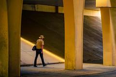 The Man with the Yellow  Hat (nixter) Tags: bridge citylife citystreet curiousgeorge nebraska omaha street talking walker walking yellow