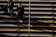 foot traffic (jhnmccrmck) Tags: melbourne victoria jhnmccrmck fujifilm fujifilmxt1 xt1 xf1855mm classicchrome 3000 parliamentstation stairs people yellow shadows explore iminexplore