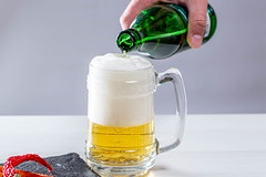 A man pours a bottle of beer in a beer glass (wuestenigel) Tags: glass bubbles full booze foam liquid background hand light beer drink beverage closeup alcohol spices mug golden chilli lager man fresh yellow pour bottle bier schaum glas cold kalt getränk voll thirst durst icee eis noperson keineperson frosty eisig liquor alkohol flasche ale aber intoxicated berauscht h2o cool pub wet nass