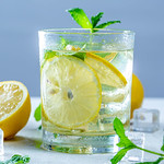 Drink with fresh lemons, mint and ice in glass thumbnail