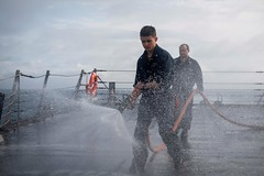 190718-N-UB406-0068SEA OF HEBRIDES (July 18, 2019) Damage Controlman 3rd Class Anthony Schultz washes the aft missile deck of the guided-missile destroyer USS Gravely (DDG 107) as the ship conducts a fresh water wash down. Gravely is underway on a regular (CNE CNA C6F) Tags: alliedmaritimecommand marcom nato snmg1 standingnatomaritimegroupone strongertogether ussgravely