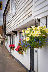 Diversion (Jez22) Tags: jeremysage photography architecture weatherboarded wooden houses street marden kent england flowers hangingbasket white yellow painted sign direction row copyright village
