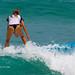 Girl in a bikini on a surf on a high wave. Nai Harn Beach, Phuket, Thailand    XOKA5758b3s
