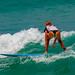 Girl in a bikini on a surf on a high wave. Nai Harn Beach, Phuket, Thailand            XOKA5756b3s