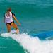 Girl in a bikini on a surf on a high wave. Nai Harn Beach, Phuket, Thailand   XOKA5759b3s