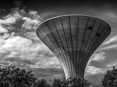 All along the water tower (Gullivers adventures) Tags: water tower life bnw blackandwhitephotography clouds flying driveby trumpet stucture building sky atmosphere trees driving landscape ireland dublin eire love roadtrip trip