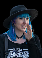 Portrait (D80_539619) (Itzick) Tags: denmark copenhagen candid color colorportrait youngwoman hat necklace earrings blackbackground streetphotography face facialexpression bluehair portrait d800 itzick