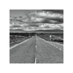 Just carry on going ! (CJS*64) Tags: blackwhite blackandwhite whiteblack whiteandblack mono monochrome road straight view longwaytogo scotland cjs64 craigsunter cjs a82 scenery travel panasonic lx100 panasoniclx100