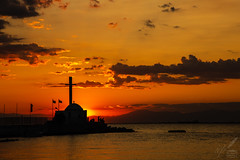 I Saw A Chapel All of Gold—W Blake (ioannis_papachristos) Tags: sunset settingsun glorioussunset belfry belltower chapel cross people street bay sea seaside seafront seashore harbor golden gold silhouette chiaroscuro lowkey dark stnicholas thessaloniki salonica thessalonike greece sky clouds photogenic joy socialize meet havinggoodtime goodtime idyllic seascape cityscape dusk twilight evening afternoon day dyingsun bluehour saintnicholas kalamaria skies scenery night july summer mirrorless canon papachristos eosrp poetry poem poemlines williamblake wblake masts pier wharf dock ships sail mood emotive emotion church harbour macedoniagreece macedoniatimeless makedonia