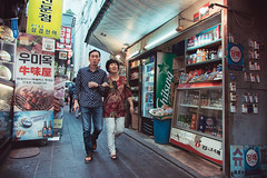 Myeong-dong Alleyway (Jon Siegel) Tags: nikon d810 sigma 24mm 14 sigma24mmf14art sigma24mmf14people korean seoul southkorea couple man woman street alleyway alley evening nostalgic life culture people wandering myeongdong