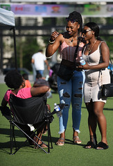 Wah Gwan, Sista? (Anthony Mark Images) Tags: prettyladies prety lovelybeautifulladies women female friends meetingfriends chair grass sunglases smiles socamusic iriemusicfestival caribbeanfestival carnival canada ontario mississauga people portrait prettygirls pinktshirt whitedress rippedjeans tanktop nikon d850 flickrclickx