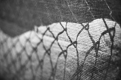 Fog Rolls In (Jeremy Beckman) Tags: blackandwhite downtownriverside fence mesh obsession chainlink fabric construction shadows metal linked summer hot detail texture abstract