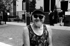 summer in Chicago (zzzweber) Tags: man beard walking wrigleyville x100f fujifilm black white noir glasses broken hat smile lakeview chicago urban street tank top hairy