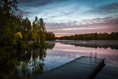 Misty dawn (mabuli90) Tags: finland lake fog mist water autumn dock wood ladder forest tree sky clouds sunrise morning dawn suomi