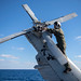 A Naval officer verifies tail rotor integrity aboard USS Chancellorsville (CG 62)