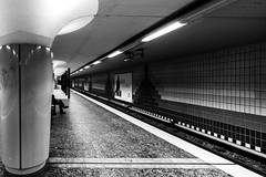 Legs on the platform / dominant line (Özgür Gürgey) Tags: 14mm 2016 bw d750 hamburg messberg nikon samyang u1 architecture grainy legs lines people platform station street subway vanishingpoint
