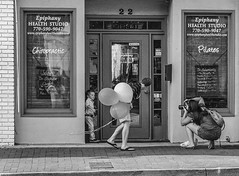 Balloons for the Model (tvdflickr) Tags: tvdimages thomas driggers photography photo by tom photobytomdriggers thomasdriggersphotography usa georgia marietta street streetphotography candid photographer child balloons windowselfie df nikon nikondf