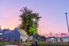 Tracks Tavern Sunset (VBuckley.com) Tags: sunset volley volleyball tracks trackstavern summer sky fun july milwaukee wisconsin riverwest colorful coedvolleyball volleyballleague wideangel bigsky beachvolleyball
