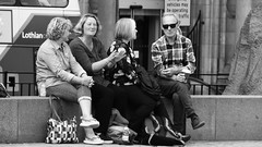 Enjoying a Blether (byronv2) Tags: blackandwhite blackwhite bw monochrome street candid peoplewatching sitting seated bench saintandrewssquare newtown edinburgh man woman chatting talking conversation edimbourg scotland people sit