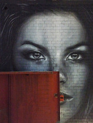 Loose Lips Sink Ships (Steve Taylor (Photography)) Tags: art graffiti mural streetart brown black grey face head brick woman lady uk gb england greatbritain unitedkingdom london eyes