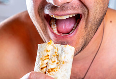 A hungry man with an open mouth and a shawarma in hand (wuestenigel) Tags: vegetable hungry fastfood bristle concept hold eat bread hand male food background pita cooking shawarma mouth fresh yellow teeth healthy man mann people menschen portrait porträt adult erwachsene face gesicht one ein smile lächeln hungrig health gesundheit mund woman frau fun spas funny lustig eye auge 2019 2020 2021 2022 2023 2024 2025 2026 2027 2028 2029 2030