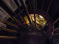 The Descent into the Wunderkabinett (Steve Taylor (Photography)) Tags: spiral windingstaircase architecture stairs staircase steps museum dark lookingdown metal uk gb england greatbritain unitedkingdom london perspective lines theviktorwyndmuseumofcuriosities
