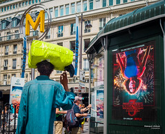Street - Upside down (François Escriva) Tags: street streetphotography paris france people candid olympus omd photo rue woman colors sidewalk man poster ad stranger things bag head yellow sign metro green blue buildings tube fun funny sun