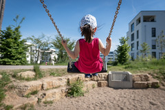 Swinging child (Manuel Gennerich) Tags: schaukeln sonnig spielplatz swinging sunnysummerday child childhood