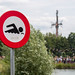 Traffic sign at the lake shows that swimming is prohibited at the Tomorrowland Festival